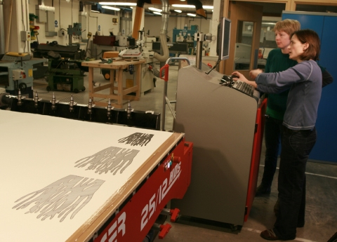 Jessie and Katie at work with the cnc router